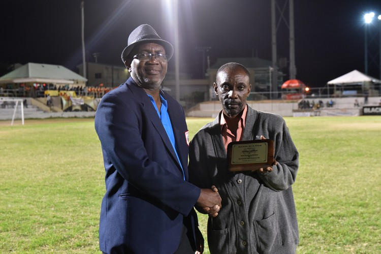 Mr. George Kinta Gilbert (right) receiving his award frrom SKNFA 1st Vice President Alistair Edwards (left)