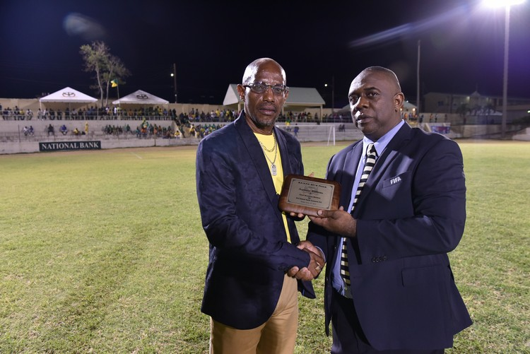 Mr. Seymour Williams (left) receiving his award frrom SKNFA President Anthony Johnson (right)